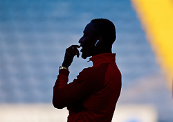 BLACKBURN, ENGLAND - Thursday, July 19, 2018: The silhouetted shape of Liverpool's new signing Naby Keita, wearing Apple Airpods, before a preseason friendly match between Blackburn Rovers FC and Liverpool FC at Ewood Park. (Pic by David Rawcliffe/Propaganda)