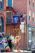 Trump supporters watch the Mifflinburg Pride Event from a fire escape on Chestnut Street.