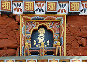 Carved slate  showing a Buddha decorated in traditional Bhutanese style on one of the 108 Chortens at Dochu La, a high pass (3140m) on the road between Thimpu and Wangdue. The chortens were built in 2005 in atonement for the lives lost in the joint action with India  in 2003 to drive Assamese militants from Bhutan. They act as a reminder that the problem still exits and that Bhutanese dissidents are involved. Dochu La, Bhutan. 13 November 2007.