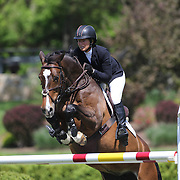 Beezie  Madden riding Vanilla in action during the $100,000 Empire State Grand Prix presented by the Kincade Group during the Old Salem Farm Spring Horse Show, North Salem, New York,  USA. 17th May 2015. Photo Tim Clayton