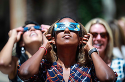 August 21, 2017 - Florida, U.S. - Fastina Nuguse of West Palm Beach  observes the eclipse at CityPlace in West Palm Beach Monday afternoon, August 21, 2017. ''It is amazing,'' she said. (Credit Image: © Bruce R. Bennett/The Palm Beach Post via ZUMA Wire)