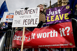 "© Licensed to London News Pictures. 13/03/2019. London, UK. Brexit supporters protest outside Parliament as MPs continue to debate a series of key votes this week. MPs will vote on whether to remove the option of a ""no deal"" departure from the EU today, after Prine Minister Theresa May's proposed deal was defeated for a second time last night. Photo credit: Rob Pinney/LNP"