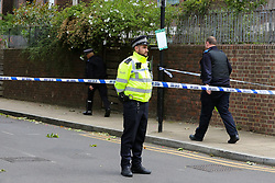 © Licensed to London News Pictures. 06/06/2020. London, UK. A police officer guards a crime scene on Brackenfield Close, Hackney in East London as police launch an investigation following a fatal shooting. Police were called at 11.30 pm on Friday 5 June, to reports of shots fired in Brackenfield Close and found a man in his twenties suffering gunshot injuries. Despite the efforts of medics and officers, the man was pronounced dead at the scene. Photo credit: Dinendra Haria/LNP
