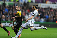 Swansea city's Chico Flores is blocked by Man city's Pablo Zabaleta. Barclays Premier league, Swansea city v Manchester City at the Liberty Stadium in Swansea,  South Wales on  New years day Wed 1st Jan 2014 <br /> pic by Andrew Orchard, Andrew Orchard sports photography.