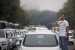 August 1, 2018 - Malaga, MALAGA, Spain - A taxi driver seen speaking on his mobile phone during the demonstration..A protest in support of the taxi drivers' strike against the unfair competition by the companies with private transport Uber and Cabify. (Credit Image: © Jesus Merida/SOPA Images via ZUMA Wire)