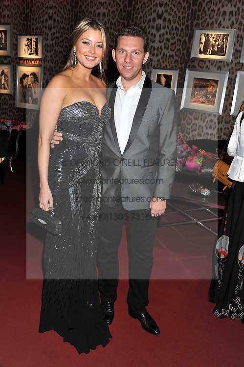 HOLLY VALANCE and NICK CANDY at a party hosted by Roberto Cavalli to celebrate his new Boutique's opening at 22 Sloane Street, London followed by a party at Battersea Power Station, London SW8 on 17th September 2011.