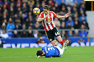 Leighton Baines of Everton slides in to tackle Adnan Januzaj of Sunderland. Premier league match, Everton v Sunderland at Goodison Park in Liverpool, Merseyside on Saturday 25th February 2017.<br /> pic by Chris Stading, Andrew Orchard sports photography.