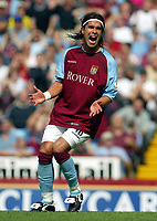 Photograph: Scott Heavey.<br />Aston Villa V Liverpool. FA Barclaycard Premiership match from Villa Park. 24/08/2003.<br />Juan Pablo Angel shows his frustration after hitting the post from a free-kick.