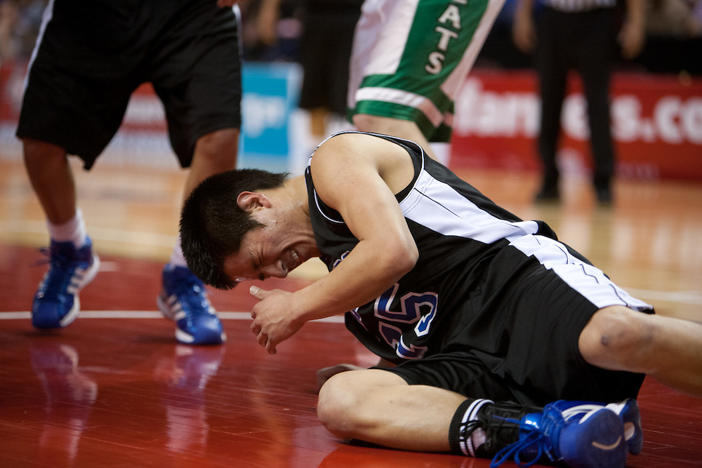 .Navajo Pine Jermaine Chee (15) reacts to getting poked in the eye during the second half of Wednesday nights game at the Santa Anna Star Center in Rio Rancho NM. Hagerman defeated Navajo Pine 76-61.