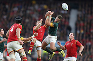 Lloyd Williams of Wales and Handre Pollard of South Africa jump for the ball . Rugby World Cup 2015 quarter final match, South Africa v Wales at Twickenham Stadium in London, England  on Saturday 17th October 2015.<br /> pic by  John Patrick Fletcher, Andrew Orchard sports photography.