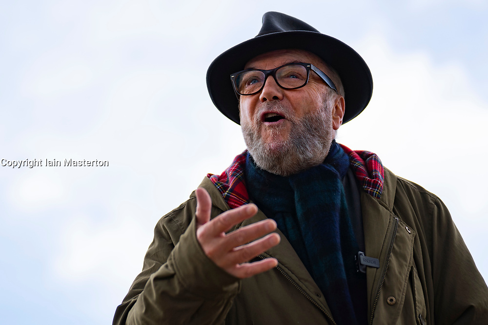 Troon, Scotland, UK. 4 May 2021. Founder of  pro Union All for Unity party George Galloway campaigns on the beach promenade in Troon in Ayrshire. Galloway made a live streamed speech and met with supporters and members of the public. He had lunch of fish and chips at The Wee Hurrie takeaway restaurant beside Troon harbour. Iain Masterton/Alamy Live News