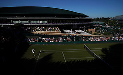 Gregoire Barrere in action against Stefanos Tsitsipas on day one of the Wimbledon Championships at the All England Lawn Tennis and Croquet Club, Wimbledon.