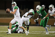 Marshall Thundering Herd quarterback Chase Litton (1) scrambles against the North Texas Mean Green during the 1st half at Apogee Stadium in Denton, Texas on October 8, 2016. (Cooper Neill for The Herald-Dispatch)