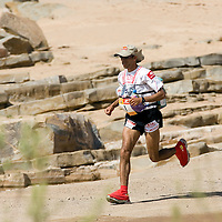 25 March 2007:  2006 winner and 9th time winner Lahcen Ahansal of Morocco runs during the first stage of the 22nd Marathon des Sables, finishing  second. The Marathon des Sables is a 6 days and 151 miles endurance race with food self sufficiency across the Sahara Desert in Morocco. Each participant must carry his, or her, own backpack containing food, sleeping gear and other material.
