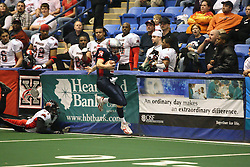 14 April 2007: Steve Lafalce narrowly escapes a tackle by Milton Proctor, but runs out of room on the side during a United Indoor Football League game that pitted the RiverCity Rage who won 29-11 against the Bloomington Extreme at the U.S. Cellular Coliseum in Bloomington Illinois..