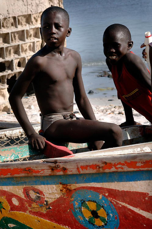 Senegal October 25, 2006 - Children playing on a fishing boat on the beach ©Jean-Michel Clajot