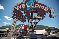 """Daniel Stewart of Yesco Signs secures the """"bucking bronco"""" sign to the top of the Cowboy Bar on Tuesday. The sign returned to Jackson after several weeks in Boise, Idaho, for restoration."""