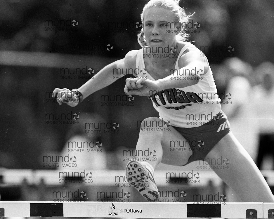 (Ottawa, Canada---07 July 1993) Leanne Wall in the 100m hurdles at the 1993 FISU World Student Games track and field team trials held at the Terry Fox Athletic Facility. Photograph copyright 1993 Sean Burges / Mundo Sport Images<br /> <br /> *****NOTE -- contact us if you want this file cleaned up before you purchase it. It takes a while to adjust each B&W image and so we have not comprehensively cleaned all B&W files before uploading them **********