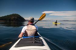Taylor and Jason Paddle On, Stuart Island, Washington, US