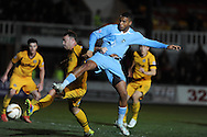 Reuben Reid of Plymouth Argyle is blocked by Newport's Darcy Blake (l).Skybet football league two match, Newport county  v Plymouth Argyle at Rodney Parade in Newport, South Wales on Tuesday 8th April 2014.<br /> pic by Andrew Orchard, Andrew Orchard sports photography.