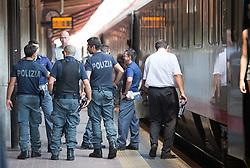 THEMENBILD - An den Bahnhöfen in Südtirol stranden seit Monaten jede Woche Hunderte Flüchtlinge. Wer es über das Meer bis nach Italien geschafft hat, versucht, rasch weiter in Richtung Norden zu kommen, meist werden sie dabei von deutsch-österreichisch-italienischen Polizeistreifen aus den Zügen geholt. Am Bahnhof in Bozen und am Brenner werden sie von Helfern versorgt. Viele der Flüchtlinge wollen nach Deutschland und Skandinavien. Der Brenner ist nur ein Etappenziel. Hier im Bild Italienische Grenz-Polizisten patrouillieren am Bahnsteig. Aufgenommen am 9. August 2015 am Bahnhof Brenner // Italian border police patrol on the railway platform at the Brenner railway station on the border between Tyrol, Austria and South Tyrol, Italy, 09 August 2015. Each Week hundreds of asylum seekers reportedly are stopped by Austrian, German and Italian police. The Austrian government has been struggling to house masses of new arrivals, as some provincial leaders and many mayors have opposed hosting asylum seekers in their communities. More than 28,300 people applied for refugee protection in Austria in the first half of the year, with many coming from Syria, Afghanistan and Iraq. EXPA Pictures © 2015, PhotoCredit: EXPA/ Johann Groder