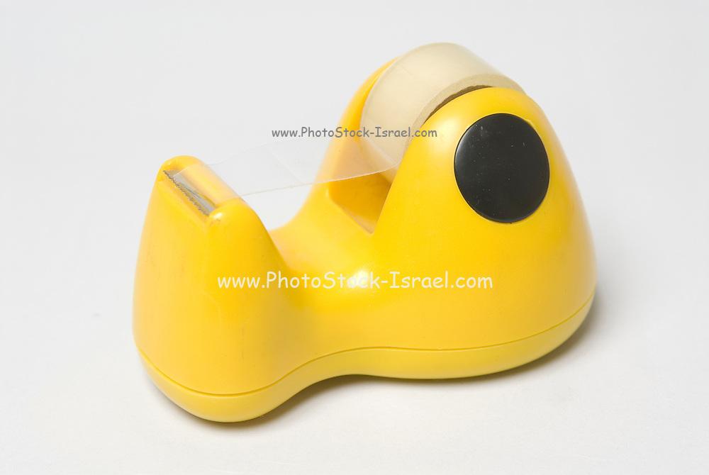yellow plastic tape dispenser on white