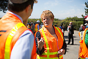 Bay Area Rapid Transit (BART) general manger, Grace Crunican, discusses the Berryessa Extension Project with other BART and VTA officials before Sen. Barbara Boxer (D-CA) arrived at the construction site of the Berryessa station for a progress and funding update in San Jose, Calif., on Aug. 21, 2012.  Photo by Stan Olszewski/SOSKIphoto.