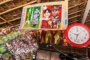 30 APRIL 2013 - MAHACHAI, SAMUT SAKHON, THAILAND:  A picture of Burmese democracy icon Aung San Suu Kyi and her father, Burmese independence hero Gen. Aung San, hangs in a Burmese tea shop in Mahachai, Samut Sakhon province, Thailand. The Thai fishing industry is heavily reliant on Burmese and Cambodian migrants. Burmese migrants crew many of the fishing boats that sail out of Samut Sakhon and staff many of the fish processing plants in Samut Sakhon, about 45 miles south of Bangkok. Migrants pay as much $700 (US) each to be smuggled from the Burmese border to Samut Sakhon for jobs that pay less than $5.00 (US) per day. There have also been reports that some Burmese workers are abused and held in slavery like conditions in the Thai fishing industry.          PHOTO BY JACK KURTZ