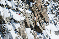 Nathan Jones a wingsuit pilot flys over the Aiguille du Midi above Chamonix, in a wingsuit.