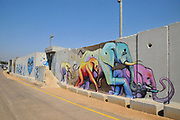 Concrete slabs on the border of Israel and Lebanon border separation wall with graffiti near the settlement of Shtula on the Israeli side