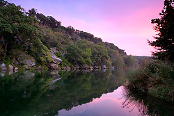Stock photo of a colorful sunset along the river in the Texas Hill Country