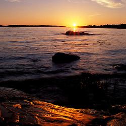 Clarks Island, ME. Sunrise.  The sun rises over the rocks.