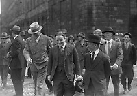 H934  Boxer Gene Tunney Training in Dublin. Walking with group around Trinity College, Dublin. August 1928. (Part of the Independent Newspapers Ireland/NLI Collection)