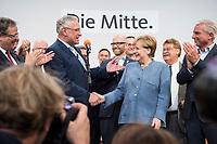 24 SEP 2017, BERLIN/GERMANY:<br /> Joachim Herrmann (Mi-L), CSU, Innenminister Bayern, und Angela Merkel (Mi-R), CDU, Bundeskanzlerin, geben sich die Hand, Wahlparty in der Wahlnacht, Bundestagswahl 2017, Konrad-Adenauer-Haus, CDU Bundesgeschaeftsstelle<br /> IMAGE: 20170924-01-099<br /> KEYWORDS: Election Party, Election Night, Haende, Hände, Handshake, Handschlag