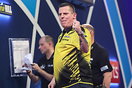 Dave Chisnall wins the fourth set against Jeffrey de Zwaan and celebrates during the PDC William Hill World Darts Championship at Alexandra Palace, London, United Kingdom on 23 December 2019.