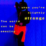 Famous Humorous quotes series: The world can be amazing when you're slightly strange with The effects of UV (black light) on reflective clothing Orange with blue background