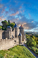 . The medieval citadel of Carcassonne, known as the Cité de Carcassonne, is a medieval fortress dating back to the Gallo-Roman period and restored by the theorist and architect Eugène Viollet-le-Duc in 1853. It was added to the UNESCO list of World Heritage Sites in 1997. The fortified city of Carcassonne consists essentially of a concentric design of two outer walls with 53 towers and barbicans to prevent attack by siege engines. Carcassonne  castle itself possesses its own drawbridge and ditch leading to a central keep. The walls of Carcassonne consist of towers built over quite a long period. One section is Roman and is notably different from the medieval walls.<br /> <br /> <br /> Visit our MEDIEVAL PHOTO COLLECTIONS for more   photos  to download or buy as prints https://funkystock.photoshelter.com/gallery-collection/Medieval-Middle-Ages-Historic-Places-Arcaeological-Sites-Pictures-Images-of/C0000B5ZA54_WD0s