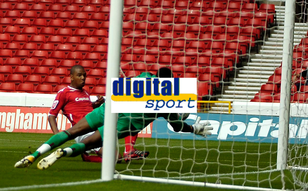 Photo: Ed Godden.<br />Nottingham Forest v Bradford City. Coca Cola League 1.<br />05/08/2006. <br />Julian Bennett puts the ball past Bradford keeper Donovan Ricketts, to make it 1-0 for Forest.