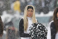 A Philadelphia Eagles Cheerleaders looks on from the sideline during the NFL game between the Detroit Lions and the Philadelphia Eagles on Sunday, December 8th 2013 in Philadelphia. (Photo by Brian Garfinkel)