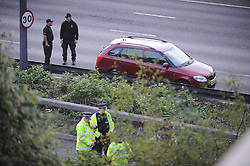 © Licensed to London News Pictures. 06/09/2013<br /> Police standing on the M25 just before the tolls, Kent side.<br /> Dartford Bridge and Tolls closed in both direct due to a security alert. One man arrested and a suspicious item found on M25. M25 CLOSED IN BOTH DIRECTIONS.  Police holding traffic on the bridge towards Kent.<br /> <br /> Photo credit :Grant Falvey/LNP