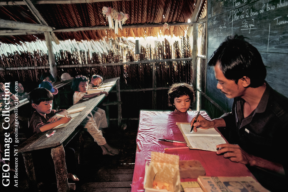 There's no escaping the teacher's attention in a one-room schoolhouse in the Mekong Delta. Vietnam