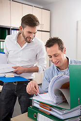 Two men office controlling checking documents