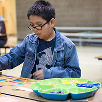 """On Thursday in Twin Lakes, 5th grader Jacob Long, 11, participates in the """"Craft Stick Challenge"""" where he is to eliminate several sticks to make more triangles during the Family Math Night held at Twin Lakes Elementary School."""