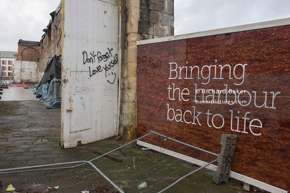 Hoardings showing as aspirational future near Bristol docks.