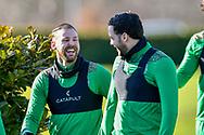Martin Boyle (#10) of Hibernian FC shares a joke with Drey Wright (#8) of Hibernian FC before the training session for Hibernian FC at the Hibs Training Centre, Ormiston, Scotland on 26 February 2021, ahead of the SPFL Premiership match against Motherwell.