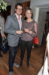 WILLIAM & LAURA SITWELL at the Linley Christmas party at Linley, 60 Pimlico Road, London on 20th November 2012.