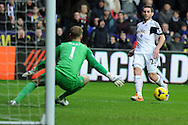 Angel Rangel of Swansea city watches as his effort goes past Man city keeper Joe Hart.Barclays Premier league, Swansea city v Manchester City at the Liberty Stadium in Swansea,  South Wales on  New years day Wed 1st Jan 2014 <br /> pic by Andrew Orchard, Andrew Orchard sports photography.