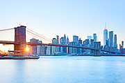 Skyline view of Lower Manhattan Financial District showing the East River, Brooklyn Bridge and One WTC, Freedom Tower, New York City.