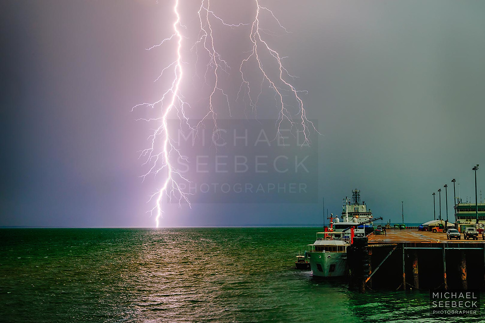 A super-intense bolt of lightning hits the waters of Darwin Harbour as a thunderstorm advances out to the Arafura Sea.<br /> <br /> Code: LATD0010<br /> <br /> Limited Edition of 125 Prints