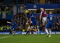 Football - 2019 / 2020 Premier League - Chelsea vs. Burnley<br /> <br /> Tammy Abraham (Chelsea FC) just misses the header which allows the waiting Callum Hudson-Odoi (Chelsea FC) to stab home Chelsea's third goal at Stamford Bridge <br /> <br /> COLORSPORT/DANIEL BEARHAM